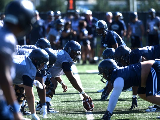 The Nevada Wolf Pack football team lines up for a play