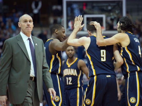 Indiana Pacers forward Damjan Rudez (9) and forward Luis Scola (4) celebrate in front of Dallas Mavericks head coach Rick Carlisle during the second half at the American Airlines Center. The Pacers defeated the Mavericks 111-100.