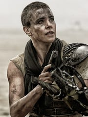 "Charlize Theron in a scene from ""Mad Max: Fury Road."""