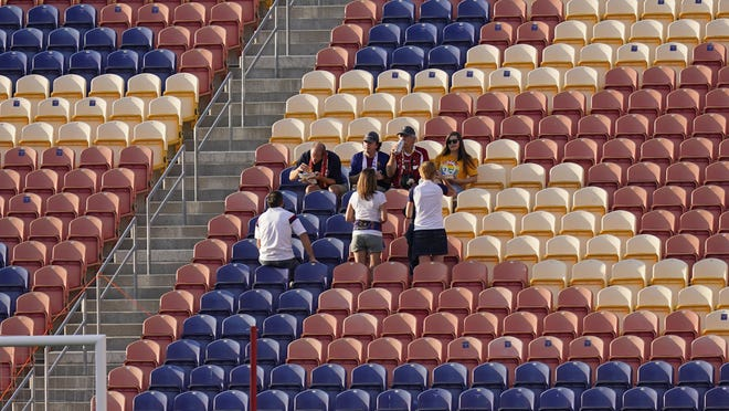 A few fans remain in the stands after the scheduled MLS game between Real Salt Lake and Los Angeles FC was postponed Wednesday, Aug. 26, 2020, in Sandy, Utah. Major League Soccer players boycotted five games Wednesday night in a collective statement against racial injustice. The players' action came after all three NBA playoff games were called off in a protest over the police shooting of Jacob Blake in Wisconsin on Sunday night.