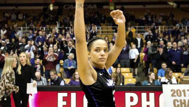 James Madison's Precious Hall, who played at FAMU DRS and Maclay, waves goodbye to James Madison fans after a loss to Elon in the Colonial Athletic Association championship game last March. She was named the Colonial Athletic Association Player of the Year twice.
