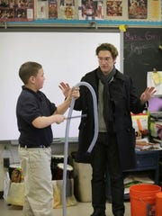Teddy Abrams, Artistic Director of the Louisville Orchestra is reenergizing the 75-year-old institution.  Abrams is seen with Heartstern Elementary student Justin Price demonstrating how common objects like a vacumm cleaner hose, can be used as a musical instrument.  Abrams will be leading classes on music making and composition as well as making musical instruments out of discarded items. March 9, 2015.