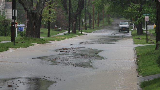 Several hours of rain in Penn Yan caused more flooding and clean up work on May 16, 2014.
