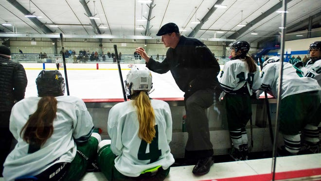 Rice Memorial girls hockey coach Aaron Miller speaks with his players during a game against South Burlington at Cairns Arena on Thursday.
