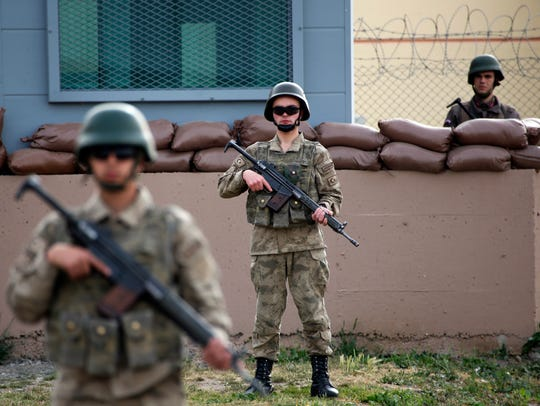 Members of Turkish forces guard the prison complex