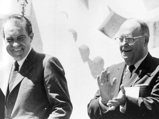 US Senator Karl Mundt from South Dakota claps as President Richard Nixon visits Madison in 1969 at the dedication of the Mundt Library in Madison.