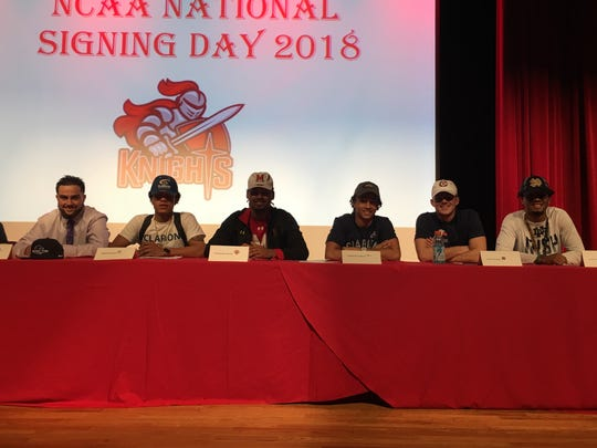 North Fort Myers High football players, from left, Dominic Covietz (Bluffton), Jamar Eason (Clarion), Fa'Najae Gotay (Maryland), Cameron Howitt (Clarion), Toby Noland (Carson-Newman) and Joe Wilkins Jr. (Notre Dame) participate in signing day ceremonies Wednesday, Feb. 7, 2018.