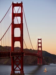 The sun begins to set on the Golden Gate Bridge in