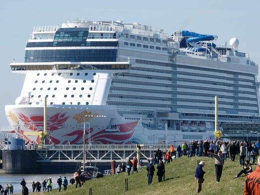 Spectators watch as the 'Norwegian Joy' cruise ship,