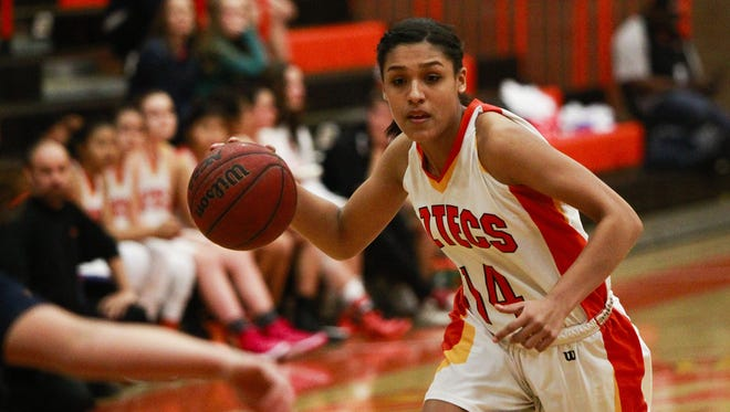 Tempe Corona del Sol's Leilani Peat drives to the basket against Gilbert Perry during their girls basketball game on Jan. 22 in Tempe. Corona del Sol defeated Perry 53-27.