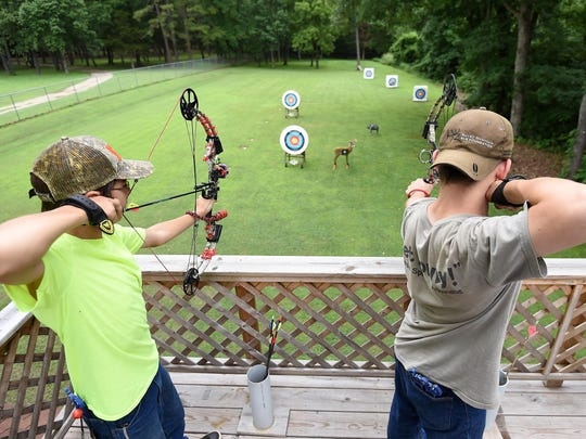 James Craker, left, and Malcolm Novak, both 14 years old, practice Wednesday for upcoming qualifying shoots for the annual urban deer hunts in Bull Shoals and Lakeview. The age of 12 is the limit for those looking to participate.