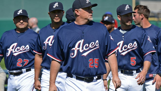 Aces manager Phil Nevin, front, and his team walk off the field after a team picture during media day at the Greater Nevada Field on Tuesday. Aces opening day is Thursday.