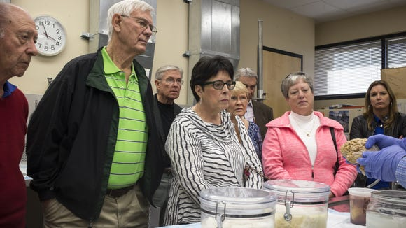 Sun City West recreation board members look at a brain being held by Banner Research Outreach Director Brian Browne (right) on January 9, 2017, during a tour of the tissue repository at the Banner Sun Health Research Institute in Sun City.
