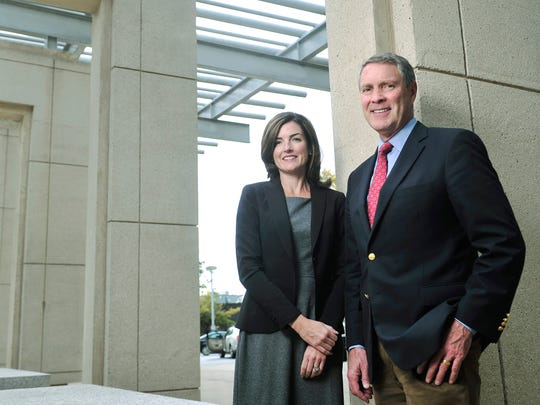 Bill Frist, right, tabbed Caroline Young, left, as