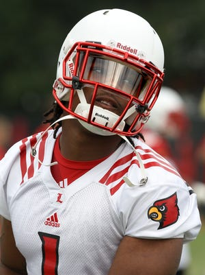 Linebacker Keith Brown chats with teammates during practice. August 5, 2014