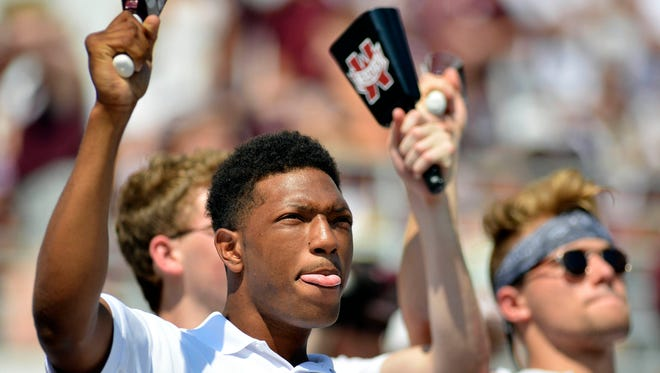 Mississippi State  fans ring cowbells during a game last season, an experience South Carolina's current players have yet to experience.