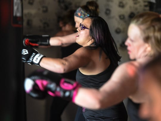 Dhani Adler leads a Spicy Boxing class Tuesday, May