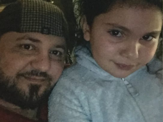 Family photo of Haydar Butris with one of his daughters.
