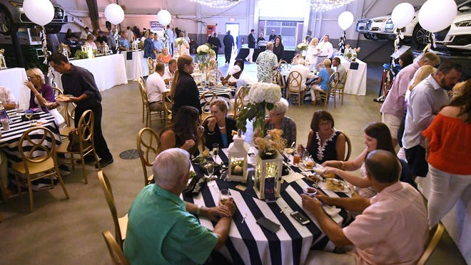 Guest enjoy the food and drinks at the Last Chance for White Pants Gala in 2019. This year's fundraiser will be a bit different due to COVID-19.