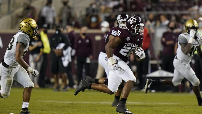Texas A&M running back Isaiah Spiller rushes for a first down during the Aggies' 17-12 win over Vanderbilt Saturday in College Station. Spiller finished the game with 117 yards rushing.