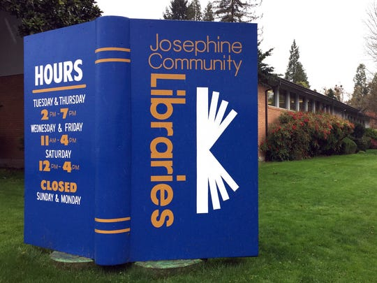 A large display stands in the lawn of the main Josephine County library branch in Grants Pass.