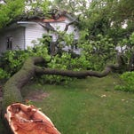 Debris rests on the ground after a garage was damaged by fallen tree during a severe thunderstorm in Traverse City, Mich., Sunday, Aug. 2, 2015. Authorities said gusts as high as 65 mph left thousands without power, damaged houses and left some roads impassable. (AP Photo/John Flesher)