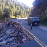 A van passes a collapsed section of U.S. Highway 34 in the Big Thompson Canyon, as seen on Sept. 24, 2013.