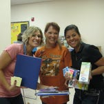 Local PNM employees donate school supplies