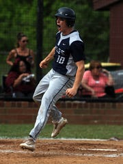 Lancaster shortstop Noah Dryden celebrates after scoring a run during Wednesday's game, May 10, 2017, at Canal Winchester High School in Canal Winchester. The Golden Gales lost the district tournament game 4-3 to Canal Winchester.