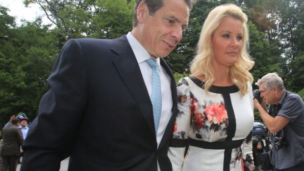 Gov. Andrew Cuomo and his girlfriend Sandra Lee arrive at the Mount Kisco Presbyterian Church to vote on Tuesday, Sept. 10, 2014.