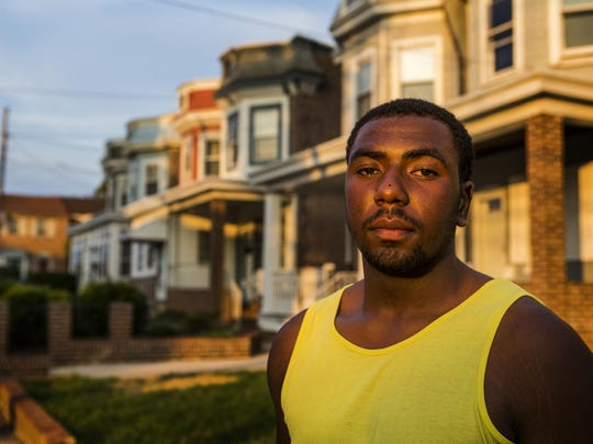 Eugene Hopkins poses for a portrait near the corner of Washington and 33rd Streets in Wilmington on Monday evening.