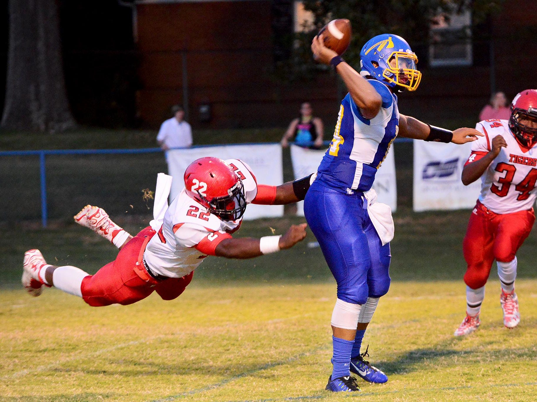 Lexington's Tariqious Tisdale reaches out to tackle North Side's Tyalen Shaw on Friday evening at North Side.