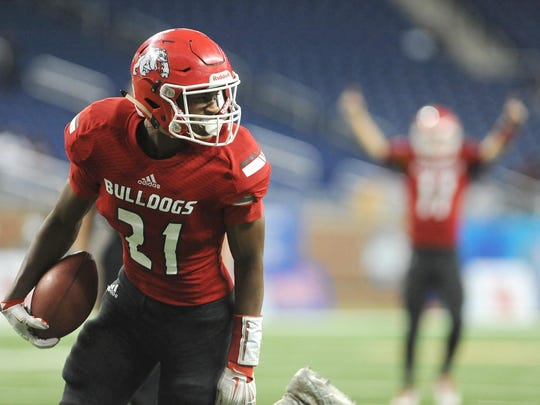 Romeo's Bradley Tanner rushed for 130 yards and three TDs in a 41-27 win over Cass Tech in the Division 1 state championship game.