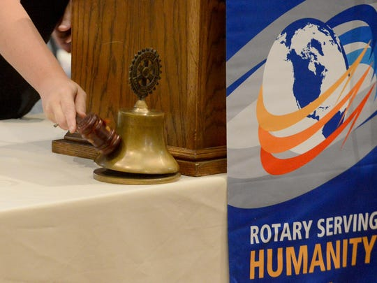 Jackson Rotary Club President Katie Pace rings the bell at the conclusion of the final July meeting. The club will be celebrating its 100th year on Aug. 3.