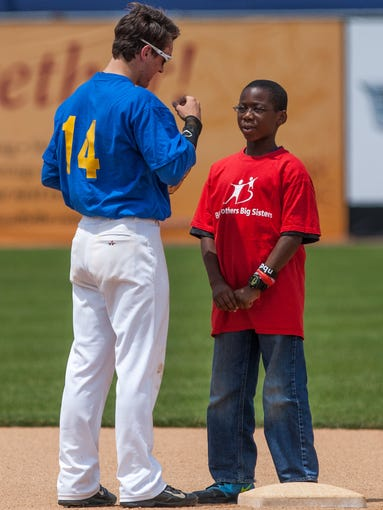 Blue's Chad Harbaugh hangs out with Big Brothers/Big Sisters little eleven-year-old Tory Jones before the start of the Blue and Gold All-Star Game at Frawley Stadium in Wilmington on Sunday afternoon, June 8, 2014.