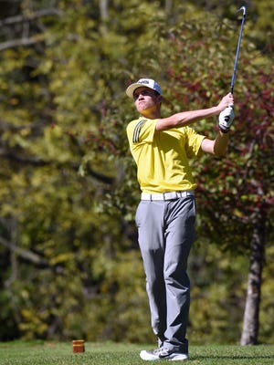 Tri-Valley's Dalton Crowley hits his tee shot on the par-3 17th hole during the Division I sectional tournament earlier this season. Crowley signed his letter of intent to play golf for Ohio Dominican on Tuesday.