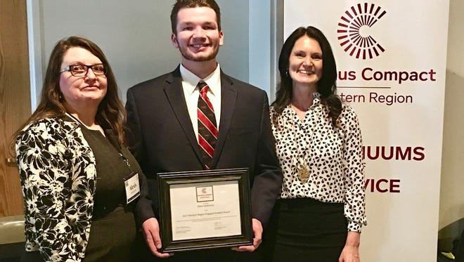 Dixie State's Dillon McKinney, center, displays the 2017 Community Engaged Student Leadership Award.