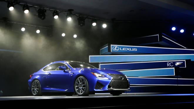 The Lexus RC F Coupe is unveiled at the at the North American International Auto Show in Detroit in 2014 file photo. Technology glitches including Bluetooth phone pairing and misunderstood voice commands dented car and truck reliability scores in a major survey of automobile owners. Lexus and Porsche tied for the top spot, leading all brands for dependability in the survey released  Feb. 22  by the consulting firm J.D. Power.(AP Photo/Carlos Osorio, File)