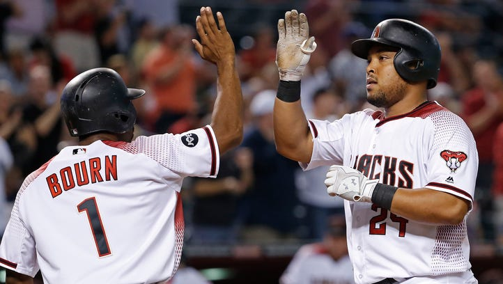 Diamondbacks' Yasmany Tomas (24) high-fives Michael Bourn (1) after a two-run homer against the Braves in the third inning at Chase Field on August 22, 2016 in Phoenix, Ariz.