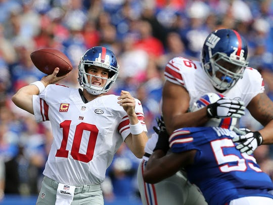 Giants QB Eli Manning threw three TD passes in a 24-10 win over Buffalo.