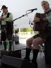 Herbert Gruber plays clarinet and Herbert Langegger the accordion at Oktoberfest in Old Town Saturday. Shoot Date:100513 Photo by Staff Photographer Robert Killips