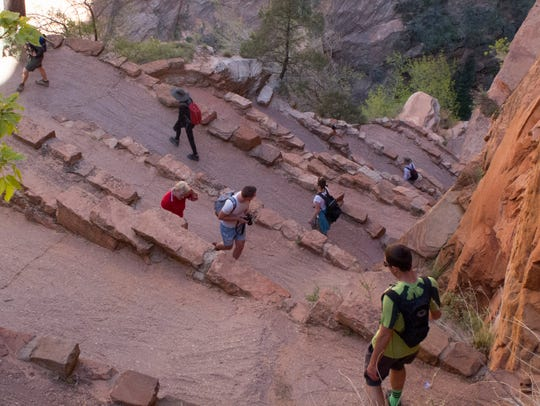 Hikers enjoy the trail to the top of Angels Landing