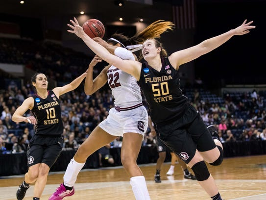 Florida State center Chatrice White (50) fouls South