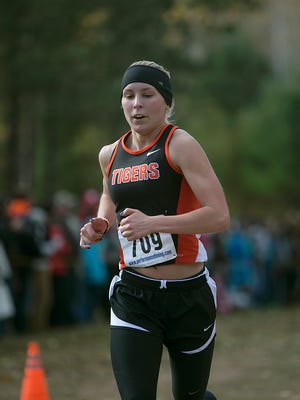 Marshfield's Morgan Irish placed 15th in the girls varsity race at the Wisconsin Valley Conference cross country meet at Nine Mile Recreation Area in Wausau, Saturday, Oct. 17, 2015.