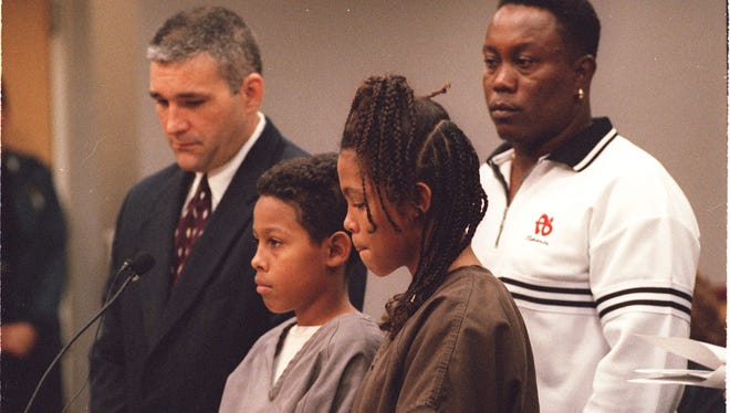 Curtis Fairchild Jones, 12, and sister Catherine Jones, 13, make their first appearance in court after the 1999 murder of their father's girlfriend.