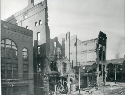 The rubble from a 1928 fire that destroyed the early YMCA building on the corner of Church and College streets.