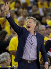 Golden State Warriors head coach Steve Kerr gestures during the first half of Game 2 of basketball's NBA Finals against the Cleveland Cavaliers in Oakland, Calif., Sunday, June 4, 2017. (AP Photo/Marcio Jose Sanchez)