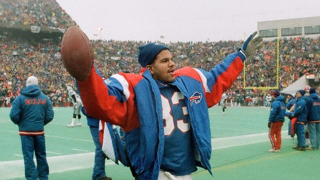 Bills Hall of Fame receiver Andre Reed celebrates on the sideline during a 51-3 blowout of the Oakland Raiders in the 1991 AFC Championship Game. The victory advanced the Bills to the Super Bowl for the first time.