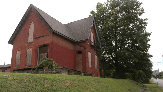 An 1868 Gothic revival house at the corner of Walnut and West Fifth streets was recently purchased by a Hayesville man. Tuesday, owner Steve McQuillin received $78,675 in Ohio historic preservation tax credits to rehabilitate the house into apartments. Total project cost is $364,700.
