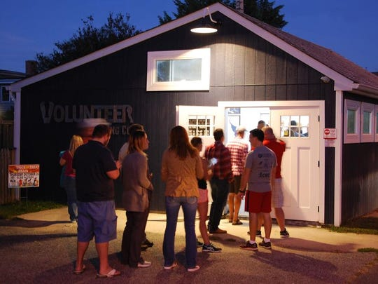 Patrons gather at the tiny Volunteer Brewing Company earlier this month. The brewery, which opened in August, is only open three days a month.